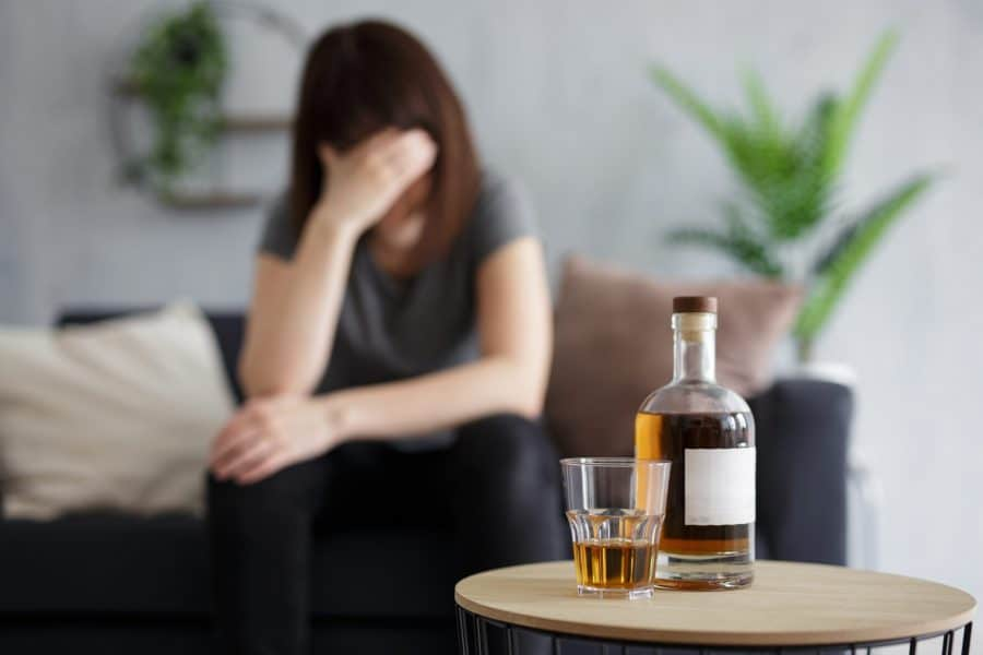 A woman trying to cope with her bipolar disorder by drinking alcohol.