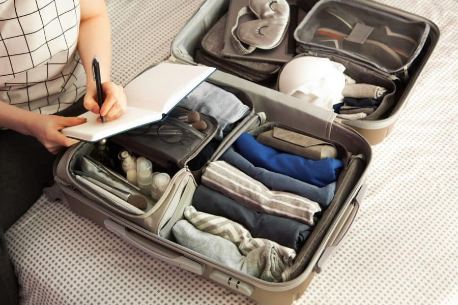 A woman packing for residential addiction treatment.